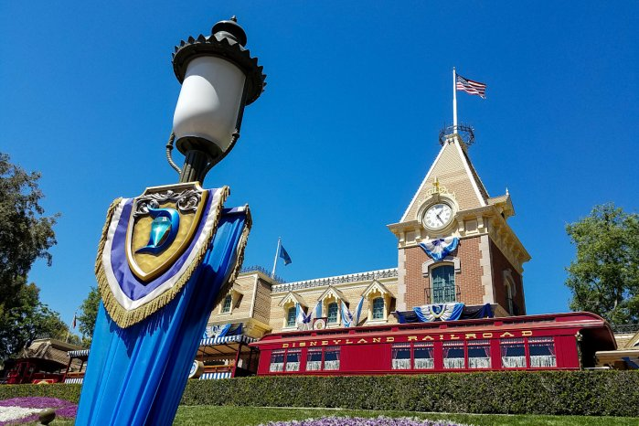 A photo of the Front Entrance Area of Disneyland with the Main Street Train Station on our Guest Traffic Slow Down Page