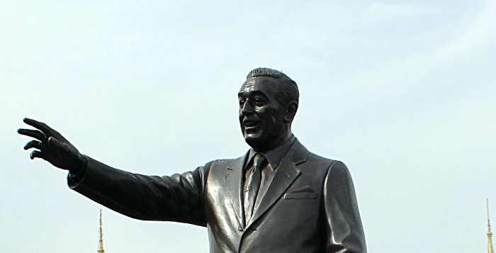 An Image of the Walt Disney Partners Statue with the Retlaw Enterprises, Inc Logo