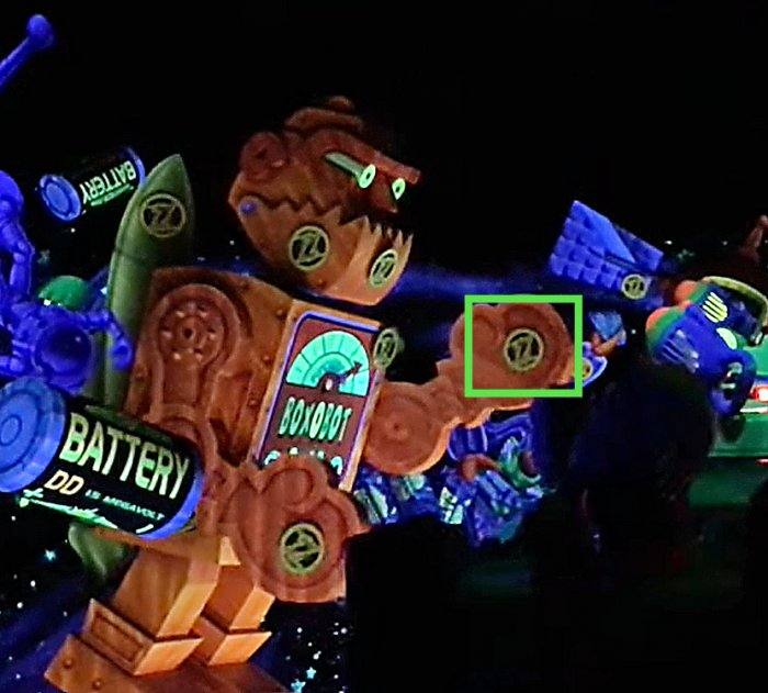 The Buzz Lightyear's Space Ranger Spin Secret Target on the orange red robot's arm