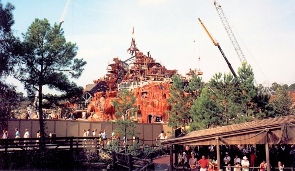 A photo of Splash Mountain under construction from a walkway in Walt Disney World